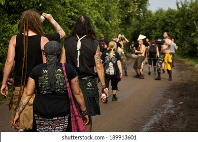 CHLESWIG-HOLSTEIN, GERMANY - AUGUST 3, 2013: Metalheads walk to the festival area at Wacken Open Air 2013
