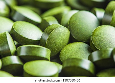 Chlorella or green barley. Detox superfood. Spirulina pills.