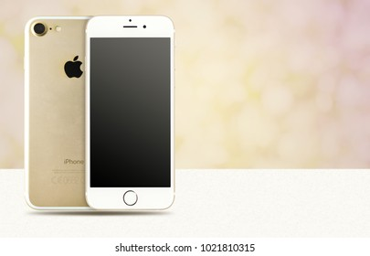 CHLUMCANY, CZECH REPUBLIC, DECEMBER 30, 2017: Apple iPhone 7 in the color gold on beatiful beige background