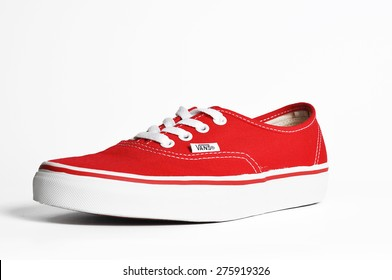CHLUMCANY, CZECH REPUBLIC, MAY 3, 2015: Vans Authentic Red sneakers on a white background