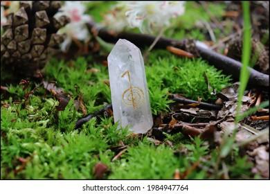 Cho Ku Rei Reiki Symbol on a clear quartz crystal with mossy background
