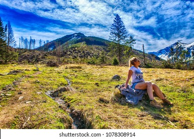 Chocholowska valley Zakopane Tatra Poland 25.04.2018 - a tourist rests in a clearing full of crocuses in the Chocholoska Valley