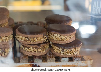 Chocolate alfajores, dulce de leche and mani stacked in showcase