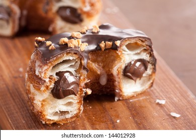 Chocolate and almond croissant and doughnut mixture on a wooden table