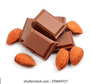 Chocolate with almonds closeup on white background .