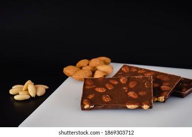 chocolate-almonds-on-black-background-26