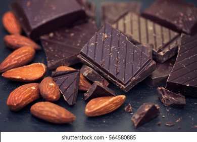 chocolate with almonds on black background