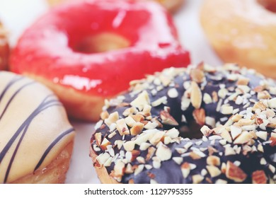 Chocolate almonds strawberry Donut isolated on white background