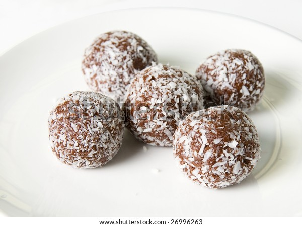 Chocolate ball at plate  isolated on white background