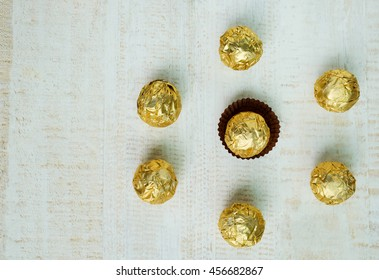 Chocolate ball wrapped in foil, Chocolates arranged in a circular shape , chocolate background
