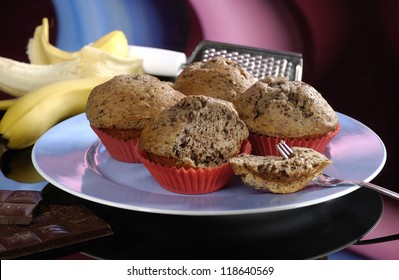 Chocolate and banana muffins on blue plate