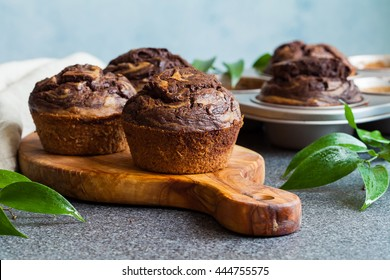 Chocolate banana muffins on the wooden board