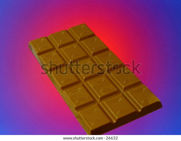 Chocolate bar against a red blue background
