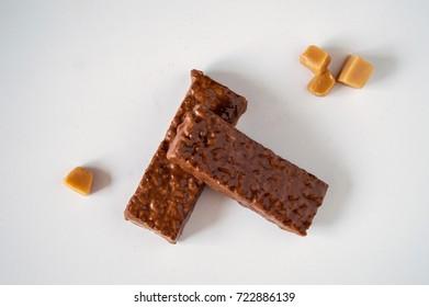 Chocolate bar with caramel, organic chocolate bar, proper nutrition, fitness, liquid caramel in decor, caramel