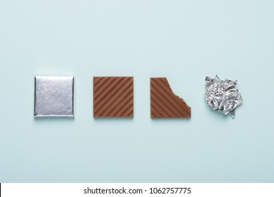 Chocolate bar life cycle on blue pastel paper background concept