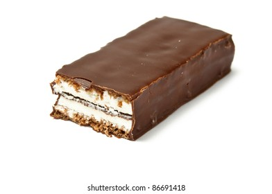 Chocolate bar with skimmings filling cut isolated on white