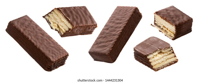 Chocolate bar whole and bitten pieces set. Cream and waffles covered with milk chocolate dessert on white background. Tasty chopped sweets broken parts close up