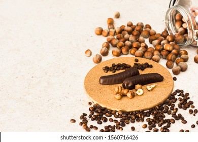 Chocolate bars with hazelnuts and coffee beans on clear background. Flat lay view