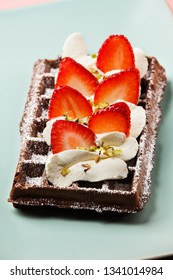 Chocolate Belgian waffles with strawberries and whipped cream