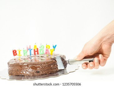 Chocolate birthday cake with candles towards white and copy space