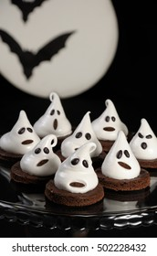 Chocolate biscuits decorated with meringue as a ghost for Halloween