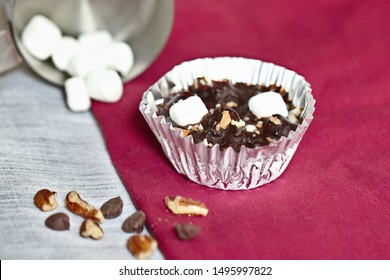 Chocolate bites with dark chocolate, marshmallows, pecans, and pretzels