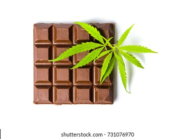 Chocolate block with marijuana leafs top view isolated