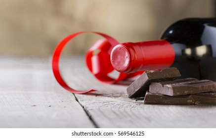 chocolate and bottle of red vine with red ribbon .valentines day