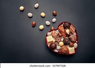 Chocolate box for Valentines Day on dark background