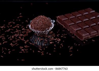 chocolate - brigadier, on black with reflexion