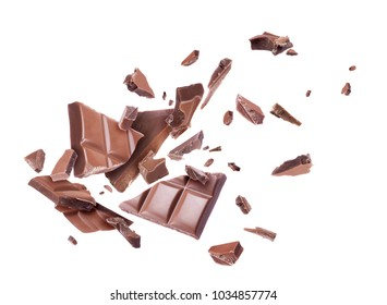 Chocolate broken into pieces in the air, isolated on a white background