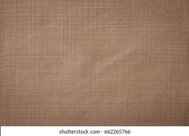 Chocolate brown linen fabric of tablecloth texture background.
