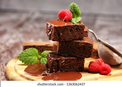 chocolate brownie cake dessert with raspberries and spices on a wooden background.