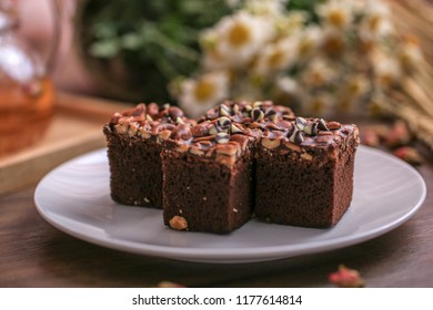 chocolate brownie with nuts on the plate