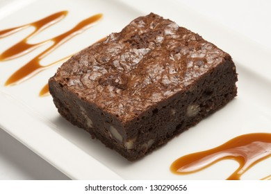 Chocolate brownie on a white plate