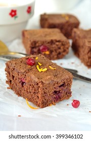 chocolate brownie with orange, cinnamon and cranberries. selective focus