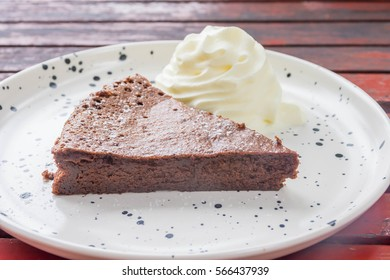 chocolate brownie with whipped cream on the table