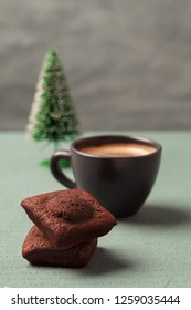 Chocolate brownies , cup of coffee and Christmas tree