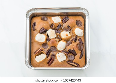 Chocolate Brownies on white marble background.