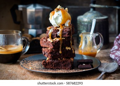 Chocolate brownies with salted caramel, vanilla ice cream and walnuts