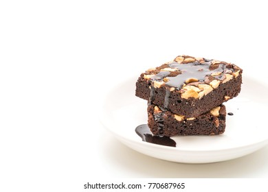 chocolate brownies with chocolate sauce isolated on white background