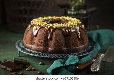 chocolate bundt cake with chocolate glaze and pistachios,
