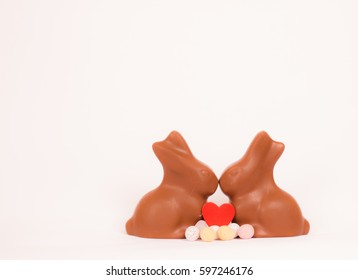 Chocolate bunnies with small eggs and heart