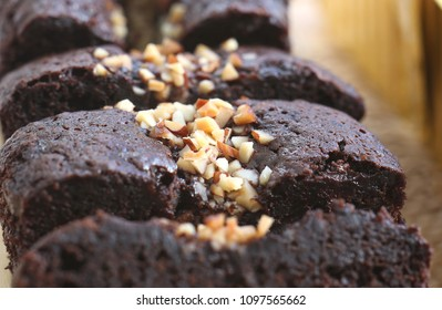 Chocolate cake with almond topping close up shot.