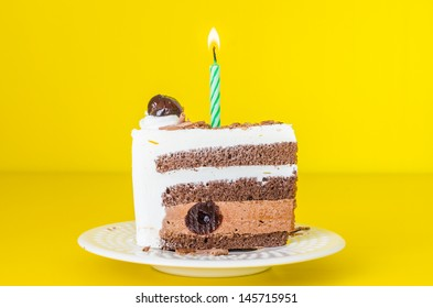Chocolate cake with black cherry in white dish&colorful background