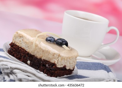 chocolate cake with blueberry and tea