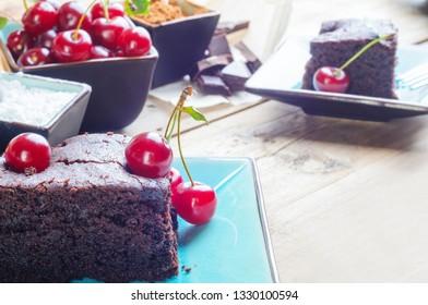 Chocolate cake - brownie - decorated with ripe cherries