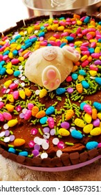 Chocolate cake with chocolate candies, Easter Eggs