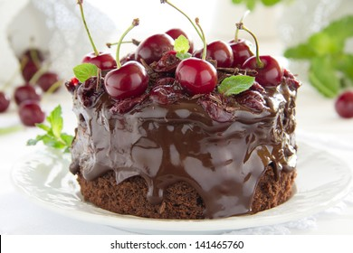 Chocolate cake with cherries and chocolate cream.