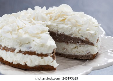 chocolate cake with coconut cream in a cut, close-up